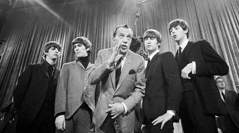 "(FILE Photo) - In this Feb. 8, 1964 file photo, Ed Sullivan, center, stands with The Beatles, from left, Ringo Starr, George Harrison, John Lennon, and Paul McCartney, during a rehearsal for the British group's first American appearance, on the ""Ed Sullivan Show,"" in New York. (Source: AP)"