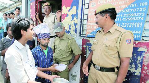 e-rickshaw drivers seek alms from policemen at Shahdara overbridge, during a protest against the ban on the battery-operated vehicles.