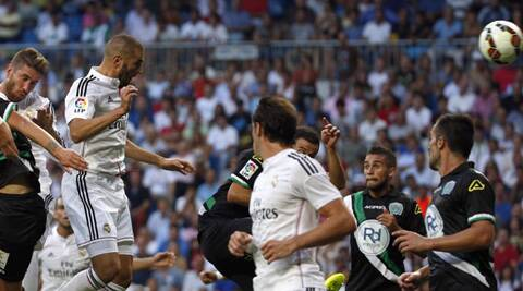 Real Madrid's Karim Benzema (L) heads the ball to score a goal against Cordoba (Source: Reuters)