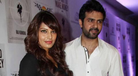 Actress Bipasha Basu admits to being in a relationship with actor Harman Baweja, but says she doesn't want to put pressure on herself to settle down.