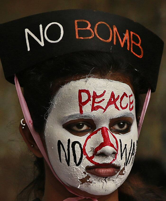 A girl with painted face participates in a peace rally to mark the 69th anniversary of US atomic bombing of Hiroshima in Mumbai. (Source: AP)