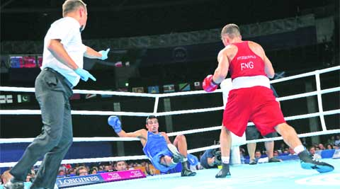 India's Mandeep Jangra was knocked down twice in one round by England's Scott Fitzgerald in the men's welterweight 69kg final on Saturday.  (Source: AP)