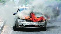 Car catches fire at Bharat Nagar Chowk, woman, son escape