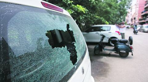 A car damaged during clashes between UPSC aspirants and police in Mukherjee Nagar on Wednesday night.  (Source: IE photo by Amit Mehra)