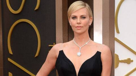 Charlize Theron blames the cosmetics world for favouring girls half her age. (Source: AP)