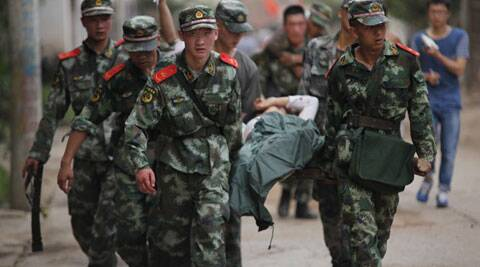 rescuers transport injured people after an earthquake in Zhaotong City in the densely populated Ludian county in southwest China's Yunnan Province. (Source: Reuters photo)
