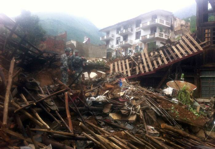 The toll from the 6.5-magnitude devastating earthquake that jolted southwest China's Yunnan province has now risen to over 380. The quake hit at 4:30 pm local time (1400 IST) on Sunday, at a depth of 12 kms with the epicenter in Longtoushan township, 23 kms southwest of the county seat of Ludian, Zhaotong City. <br /><br />  Visuals of a strong earthquake in southern China's Yunnan province that toppled thousands of homes on Sunday. (Source: AP)