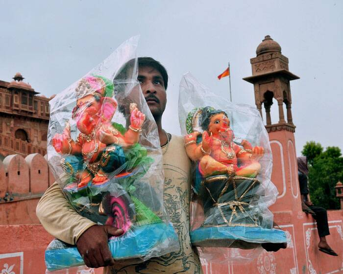 A vendor selling idols of Lord Ganesh on the eve of Ganesh Chaturthi in Bikaner. (Source: PTI)