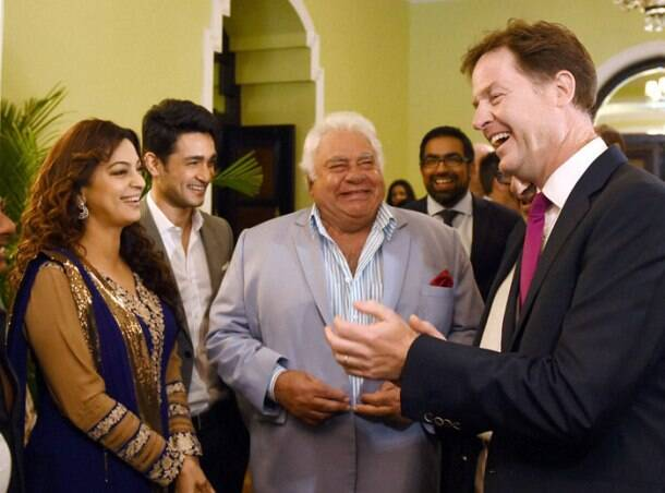 British Deputy PM's Mumbai outing - a meeting with Kapil Dev, visit to Bollywood film set