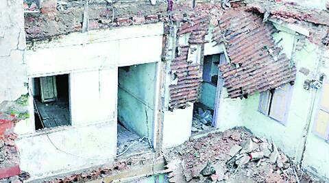 Debris of a two-storey house at Koili Fadia in Vadodara's old city area on Friday. Bhupendra Rana
