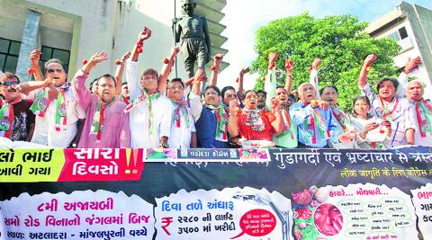 Congress party workers wear 'tomato rakhi' to protest against the sharp rise in the price of vegetable, in Vadodara on Saturday. (Source: Express photo by Bhupendra Rana)