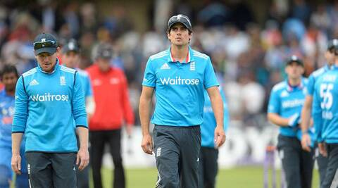 Alistair Cook leads his team back to the pavilion after being handed over a defeat on Nottingham on Saturday. (Source: Reuters)