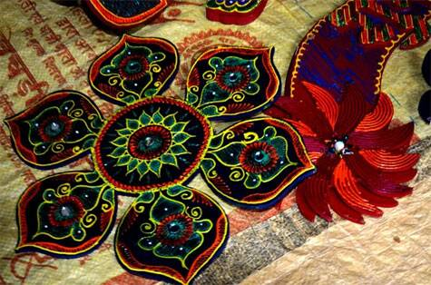 Once the painting is over, the handicraft is decorated with mirrors, sequins and beads (Source: Swasti Pachauri)