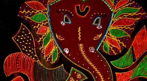 A beautiful Ganpati made on a fiber board layout with acrylic colors