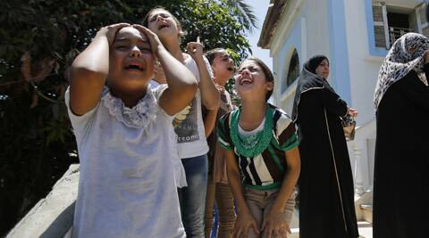 Palestinian relatives of Islamic Jihad militant Shaaban Al-Dahdouh, who was found under the rubble on Wednesday, cry during his funeral in Gaza City. (Source: AP)