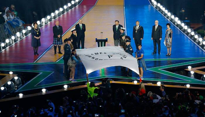 The flag of the Commonwealth Games readied to be handed over to officials the during the Closing Ceremony for the Commonwealth Games Glasgow 2014, at Hampden Park stadium, in Glasgow. (Source: AP)