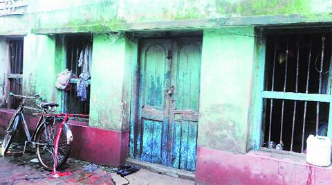 The locked house of the victim's house in South 24-Parganas, Sunday. Express photo