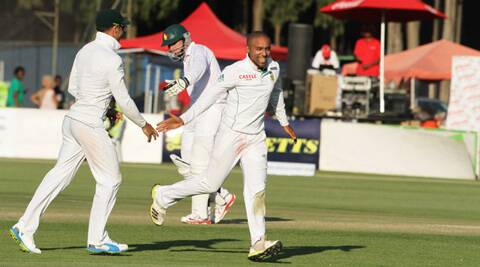Dane Piedt celebrates the wicket of Brendan Taylor (Source: AP)