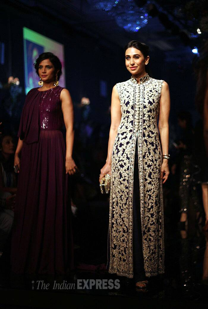 Manish Malhotra's good friend Karisma Kapoor, who was at the finale to cheer for her younger sister Kareena Kapoor, was in an ornate long jacket. She picked the outfit showcased by Manish at 'Happy New Year' trailer launch earlier this month.  (Source: Express photo by Pradip Das)