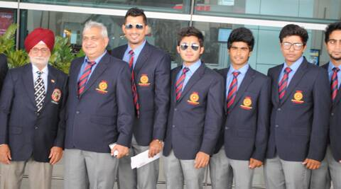The DBCC players with Dronacharya awardee coach Gurcharan Singh at the Delhi airport before leaving for their England tour. (Express Photo)