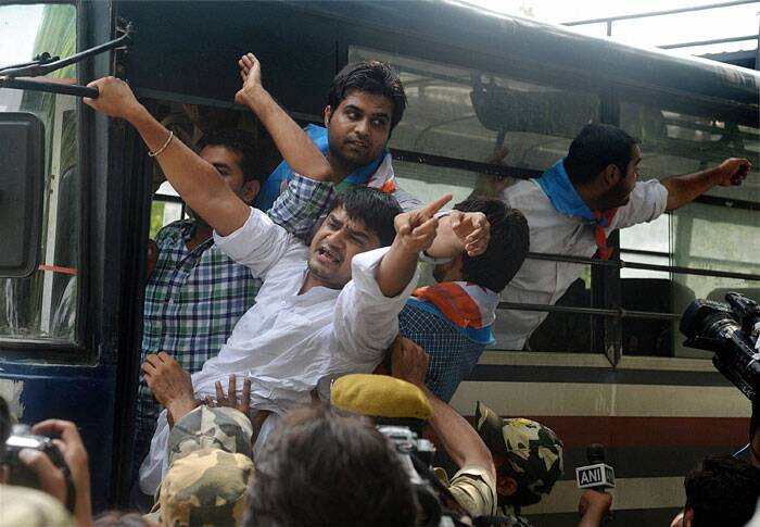 Police detaining NSUI members during a protest against CSAT format in New Delhi on Saturday. (Source: PTI)