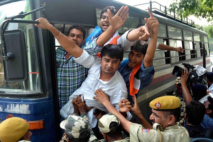 Police is seen detaining NSUI members during a protest against CSAT format in front of residence of Union Home Minister Rajnath Singh in New Delhi on Saturday. (Source: PTI)