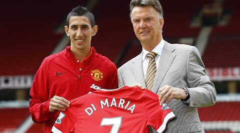 Manchester United's new signing Angel Di Maria (L) poses for a photograph with his shirt and with manager Louis van Gaal at Old Trafford in Manchester. (Source: Reuters)
