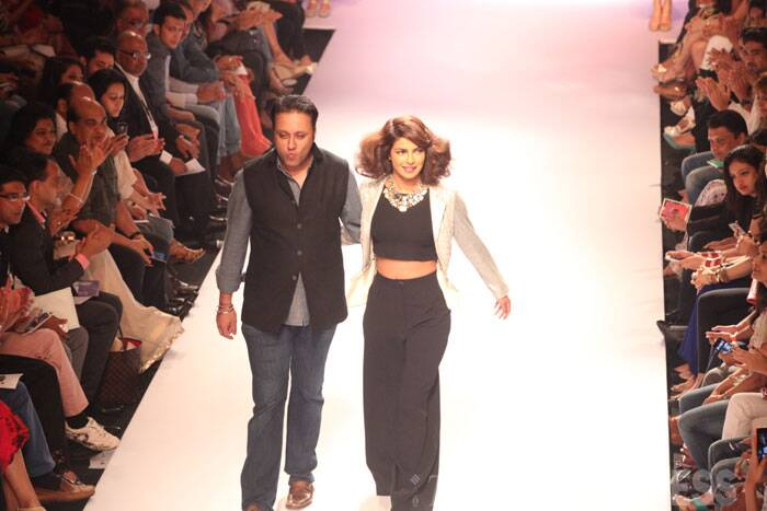 "Priyanka Chopra with the man himself - designer Varun Bahl on the ramp.  ""As per my fashion sense, I like clothes that are normal. I get really shy with fancy clothes and this outfit is very wearable and comfortable,"" said the actress sharing her taste and choice in clothes.  (Source: Express photo by Dilip Kagda)"