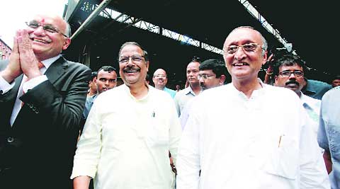 Chairman of Ruia Group Pawan Kumar Ruia with ministers Maloy Ghatak and Amit Mitra during the reopening of Jessop factory at DumDum on Saturday. (Source: Express photo by Subham Dutta)