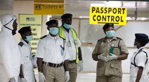 Nigerian port health officials wait to screen passengers at the arrivals hall of Murtala Muhammed International Airport in Lagos, Nigeria. Source: AP photo