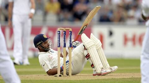 Ajinkya Rahane reacts after falling, trying to leave a bouncer during the fourth Test against England. (Source: Reuters)