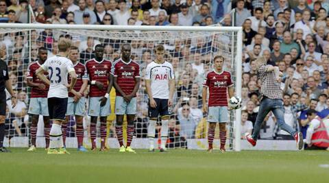 The fan ran onto the pitch and took the free kick much to the amazement of players and viewers. (Source: AP)