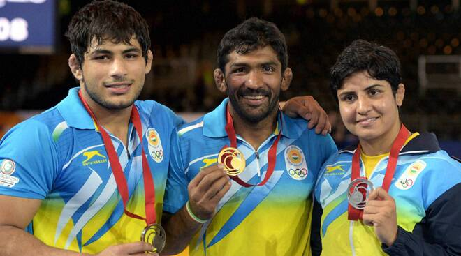 Gowda's golden throw, Yogeshwar, Babita fetch wrestling golds