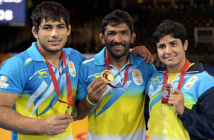 The wrestlers with their medals. Pawan (L), Yogeshwar (C) and Geetika (R). (Source: PTI)