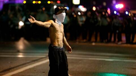 A man stands in the street during a protest. (Source: AP)
