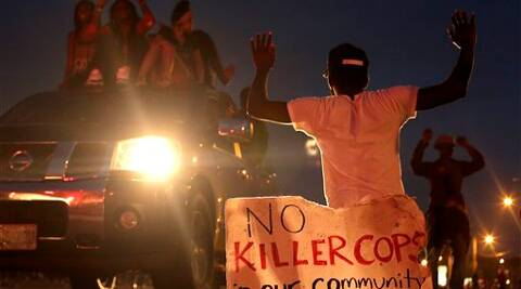 People protest Sunday, Aug. 17, 2014, for Michael Brown, who was killed by a police officer last Saturday in Ferguson. Source: AP Photo