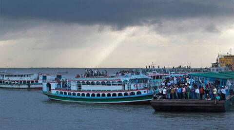 Rescuers were struggling Tuesday to locate a sunken ferry that was overloaded and carrying hundreds of passengers when it capsized in a river in central Bangladesh, leaving at least two people dead and probably many more. (Source: AP)