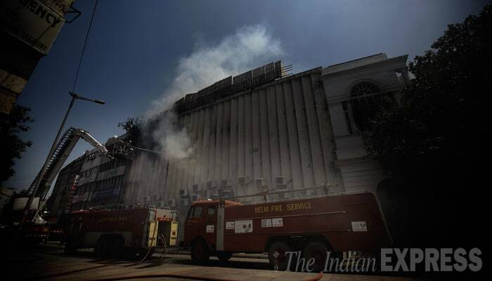 """There is a fitness centre above the office on the second floor. People there saw smoke and informed the fire department,"" he said. (Source: Express photo Praveen Khanna)"