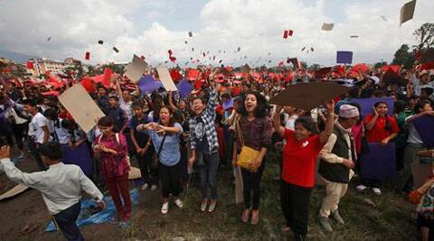 Nepalese celebrate after participating in an attempt to break the record for the largest human national flag, in Katmandu, Nepal. (Source: AP)