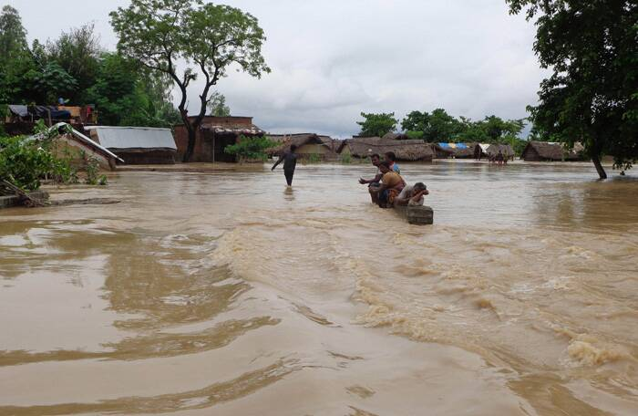 A view of a flooded road in Tikonia area near Indo-Nepal border in Lakhimpur Kheeri, Uttar Pradesh on Sunday. (Source: PTI photo)