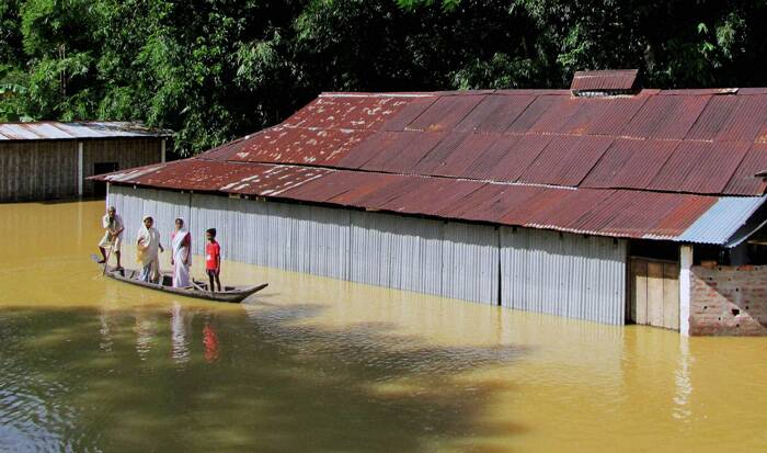 The flood situation in Assam turned critical with the water level of the Brahmaputra and its tributaries rising alarmingly in Upper and Central Assam districts. (Source: PTI)