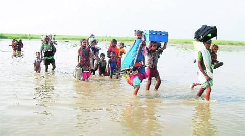 Villagers in Supaul district on their way to safer, drier places on Sunday. Source: PTI