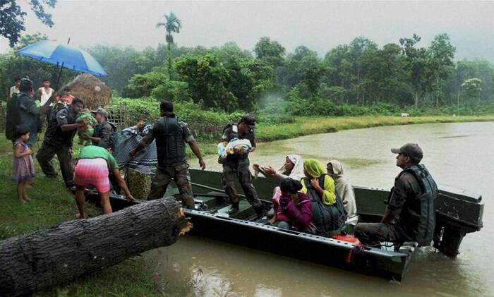 Army troop rescuing people from flood affected Kalapani village in Nagaon district of Assam on Sunday. (Source: PTI)