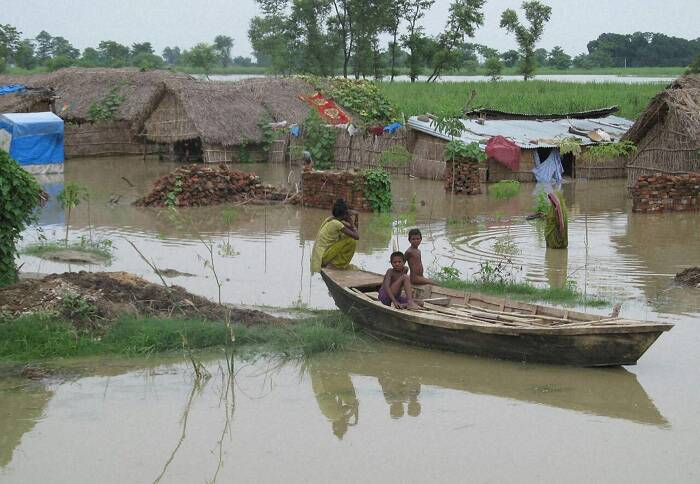 Children in a boat at a flood affected village in Dhaurehra Tehsil in Lakhimpur Kheeri, Uttar Pradesh on Sunday. (Source: PTI)