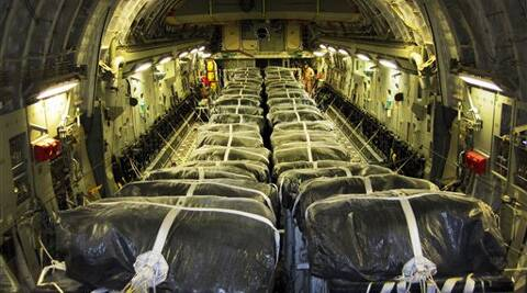 This image provided by the U.S. Defense Department shows pallets of bottled water are loaded aboard a U.S. Air Force C-17 Globemaster III aircraft in preparation for a humanitarian airdrop over Iraq . Source : AP Photo