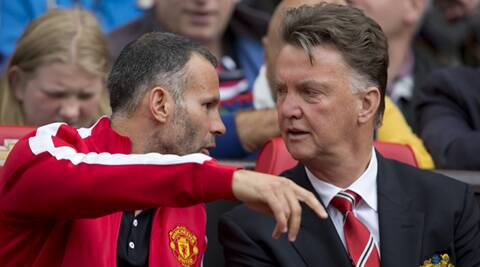 "Louis van Gaal (R) has poured scorn on critics who he says have made a ""devil"" of him after one defeat. (Source: AP)"
