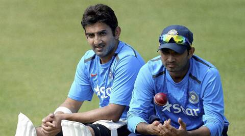 Gautam Gambhir and Mohammed Shami relax during after the practice session at Old Trafford on Tuesday (Source: AP)