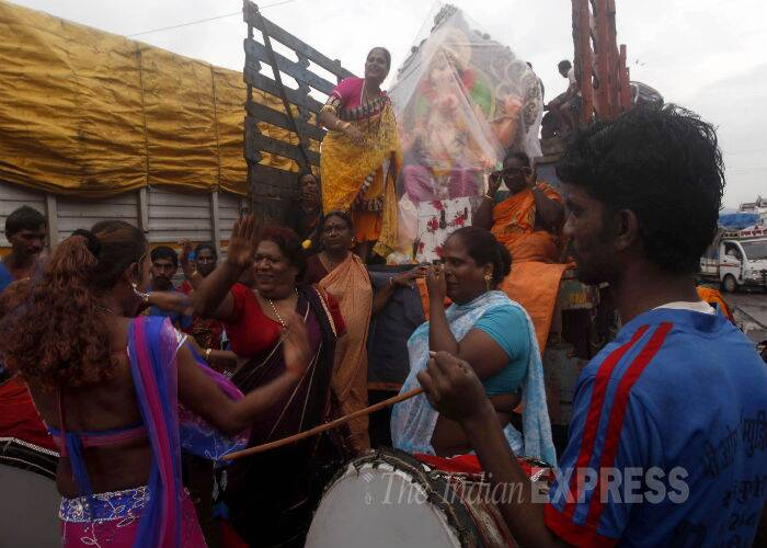 The eunuchs dance and sing as they accompany the idol to a pandal. (Source: Express Photo By Narendra Vaskar)