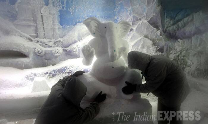 Artists work on a ganpati idol made of natural pure snow in Kurla, Mumbai. (Source: Express photo by Prashant Nadkar)
