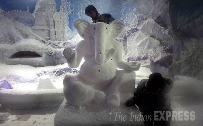 Ganesh Chaturthi is just a day away and the artists are busy giving finishing touches to the Ganpati idols.  Ganesh Chaturthi is on August 29. (Source: Express photo by Prashant Nadkar)